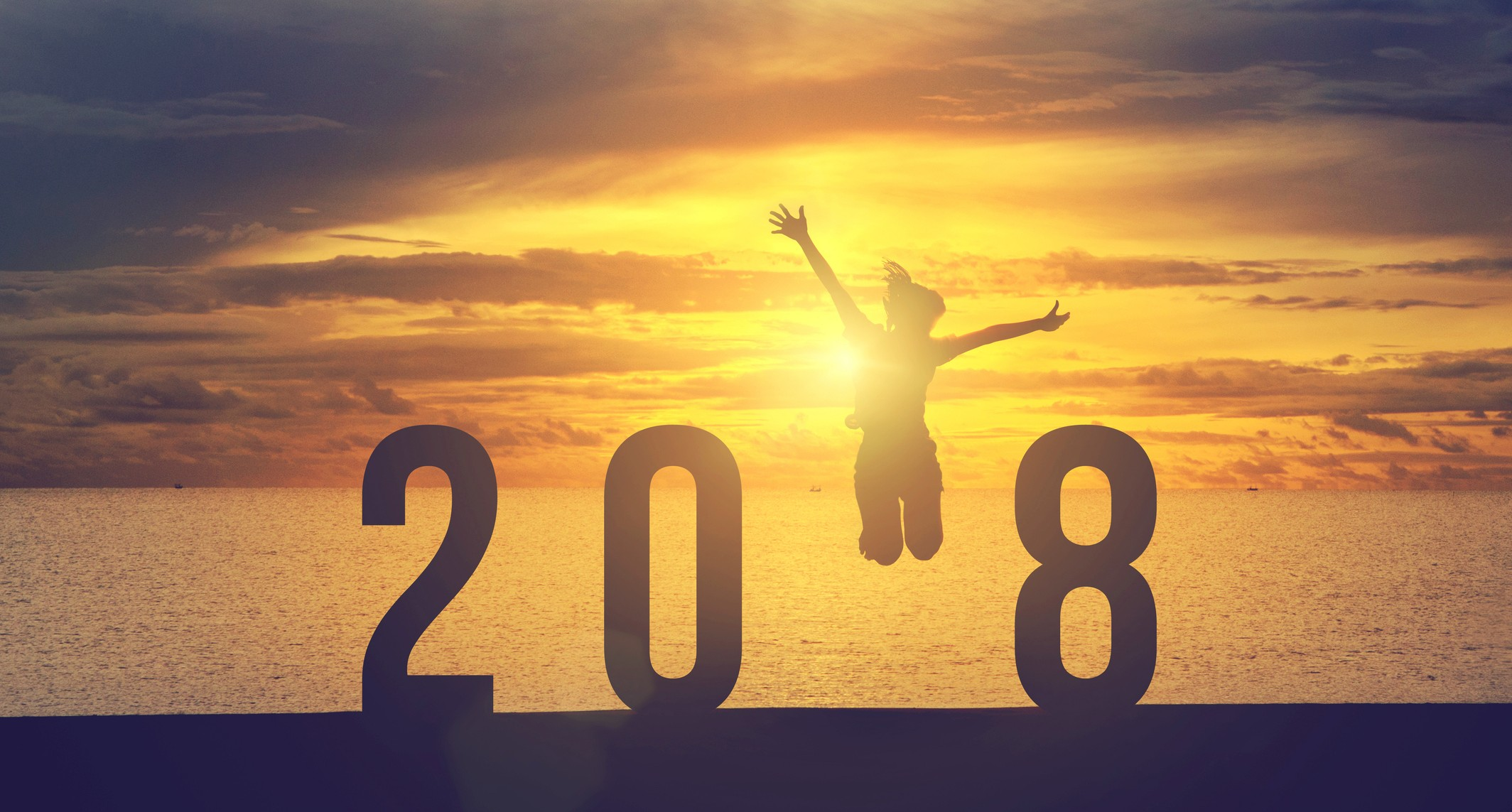 Silhouette young woman jumping to 2018 new year, success concept